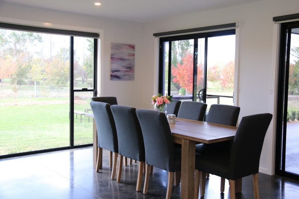 Glen Innes Builders, David Reid Homes New England love the use of polished concrete floors.  This dining has lovely windows to the floor for passive heating.