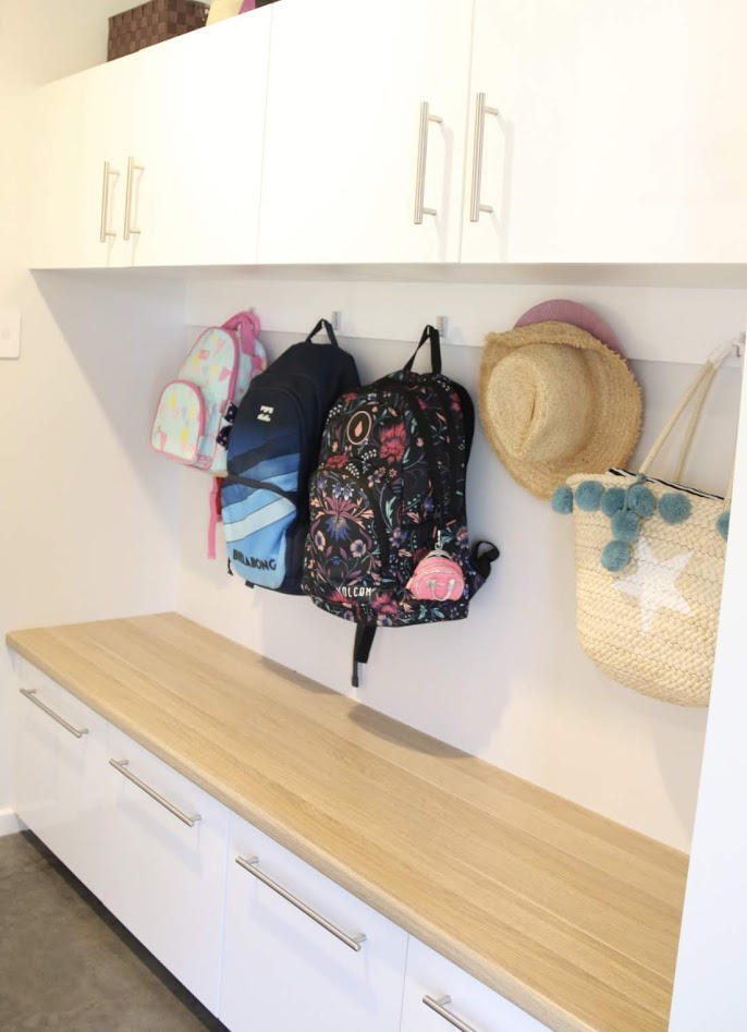 A dropzone for family organisation.  Practical joinery that makes the drop off on the way into house a breeze.