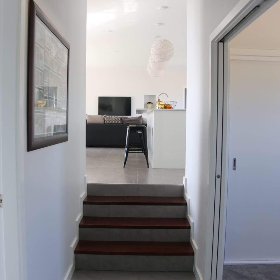 A split level from the open plan living into the hallway adds interest to this home.