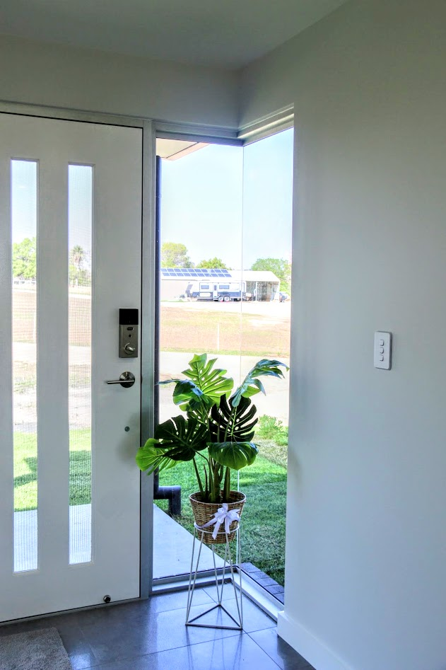 Glass corner windows look fabulous in the entry.  A schlarge Key pad opening door lock is a bonus feature.