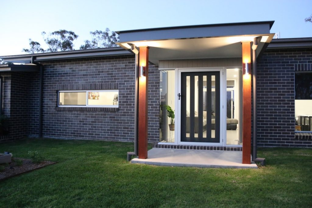 The Inverell Builder designed this with 2 glass corner windows in the front entry.  Up and down lighting feature on the Merbau timber posts.